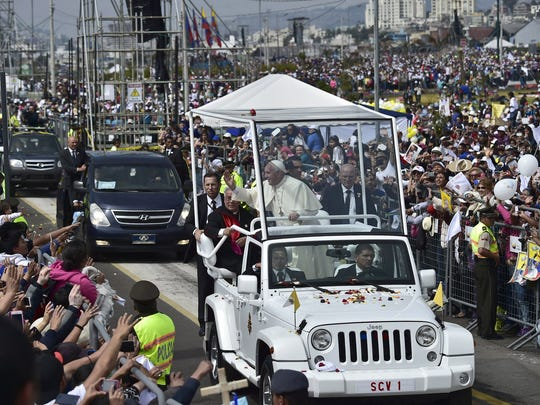 Pope Francis waves believers after an open-air mass at the Bicentennial Park in Quito, Ecuador, on July 7, 2015. The visit of the Argentine-born pontiff comes amid widespread unrest over the socialist policies of President Rafael Correa --who is expected to attend the mass.