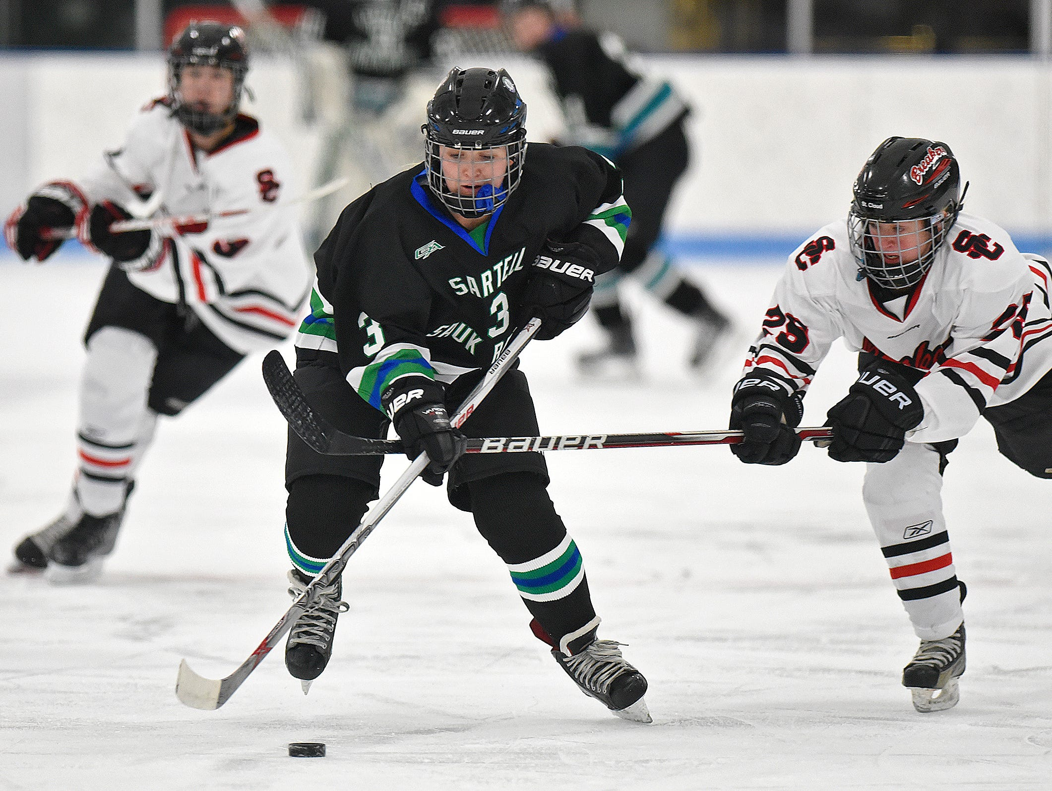 Bria Fern skates with the puck for Sartell/Sauk Rapids during the first period of Thursday's game against the Icebreakers at the MAC in St. Cloud.