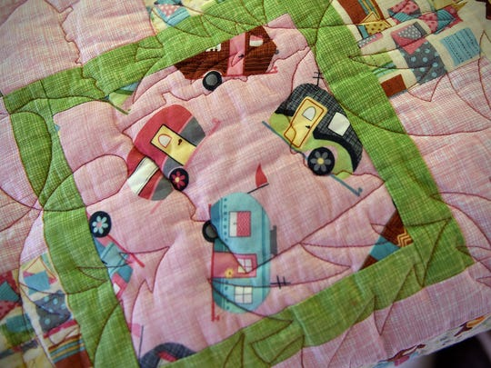 A custom quilt featuring small campers is right at home in Sue Notch's 1965 Pathfinder trailer.