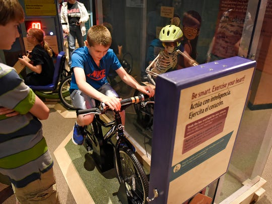 Children take part in an interactive display as part of the Healthyville exhibit Thursday, May 26, at the Stearns History Museum in St. Cloud.