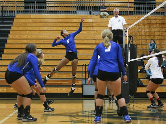 McNary's Sydney Hunter goes up for a spike in a game