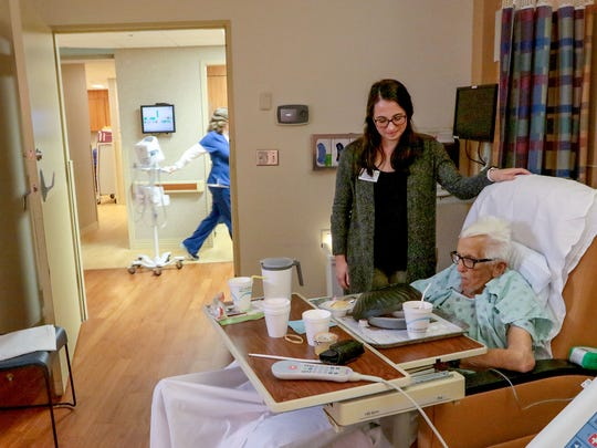 Donald Durham, right, talks with AnMed Health discharge planner Jenny Gillespie, left, before going from the hospital to Brookdale Anderson senior living community.