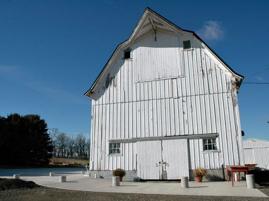 This Feb. 2, 2017 photo shows, Brad and Carla Miller's dairy barn that they transformed  along with the surrounding grounds into The Barn on the Hill, for weddings, rehearsals, showers, class reunions, anniversary and birthday parties in Leaf River, Ill. The Barn on the Hill features a large concrete patio around two sides of the barn to give guests flexibility for celebrations inside, outside, or both.