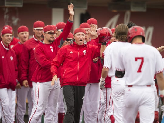 Indiana celebrates a two run seventh inning as IU beat