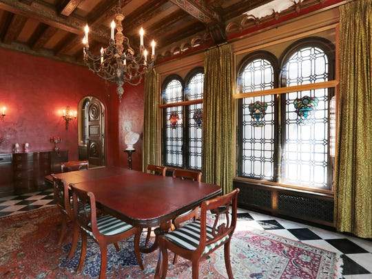 Formal dining room with leaded stained glass windows