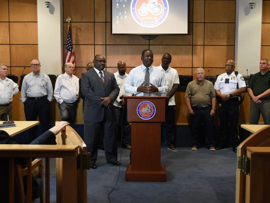 Columbus Police Chief Oscar Lewis, flanked by city