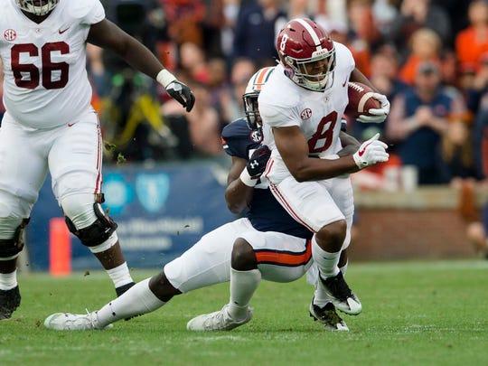 Auburn linebacker T.D. Moultry (55) tackles Alabama