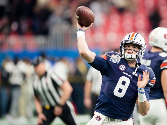 Auburn quarterback Jarrett Stidham (8) throws a pass before the Peach Bowl between Auburn and Central Florida on Monday, Jan. 1, 2018, at Mercedes-Benz Stadium in Atlanta, Ga.