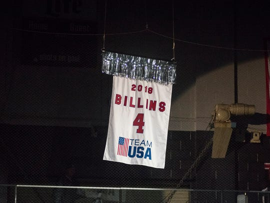 A banner recognizing Chad Billins, of Marysville, is