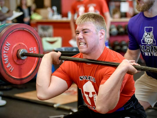 Carter Fish, Albany, pushes up 245 pounds during the Spartan Challenge Tuesday, July 31, 2019 at Rocori High School in Cold Spring. Area athletes competed in weight lifting, a 40-yard dash, vertical jump and agility events.