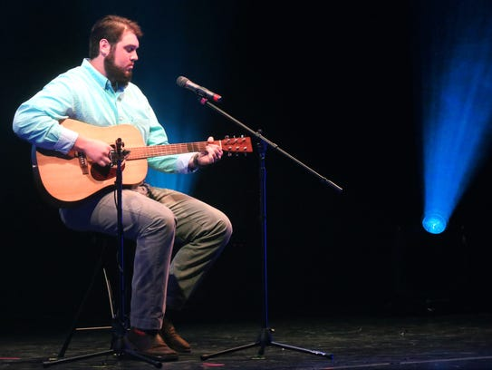 MTSU football player Hunter Rogers performs at The