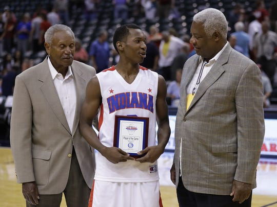 Oscar Robertson (right) and Jumpin' Johnny Wilson (left), present Eugene German as the Indiana All-Stars Player of the Game, June 11, 2016 at Bankers Life Fieldhouse.