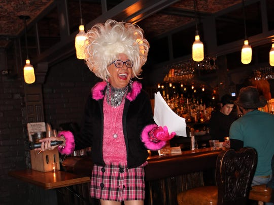 Drag queen, Bella da Ball, hosts Trivia Night in the Amigo Room at Ace Hotel and Swim Club in Palm Springs on Monday, December 5, 2016.