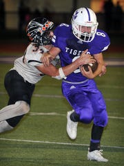 Jacksboro runningback Tyler Harmonson (8) is tackled by Nocona's Tanner Cable (34) during second quarter action Friday night in Jacksboro.