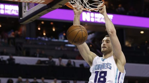 The Charlotte Hornets traded Christ School graduate Miles Plumlee to the Atlanta Hawks on Tuesday night.