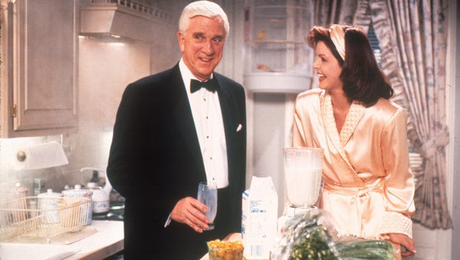 "Leslie Nielsen and Priscilla Presley star in ""Naked Gun 2 1/2: The Smell of Fear."""