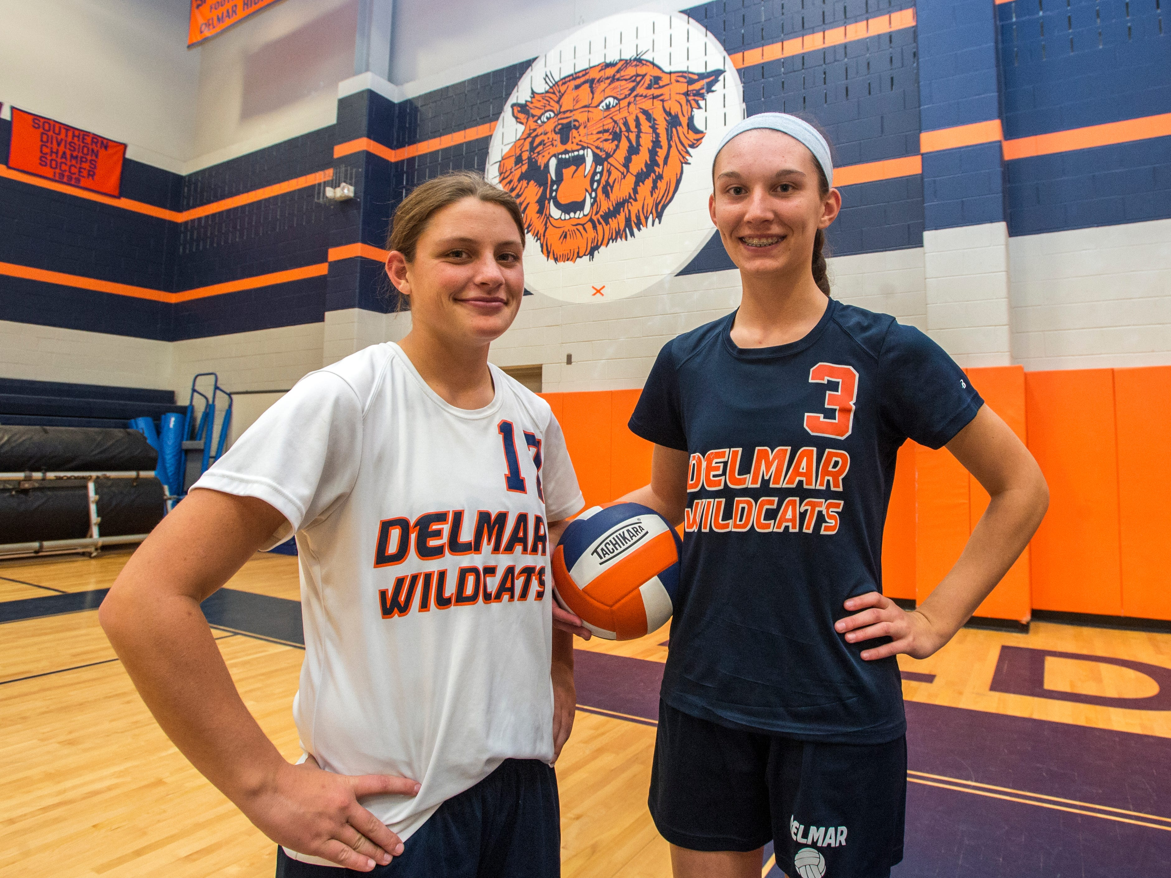 Ashton Riddle, left, and Carly Covington are captains of Delmar's volleyball team.