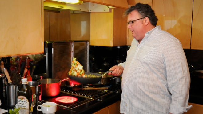 Celebrity chef David Burke cooking in his Fort Lee kitchen