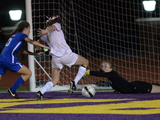 St. Scholastica goalie Elizabeth Kalmbach lays out to prevent a shot by Hope Miletello.