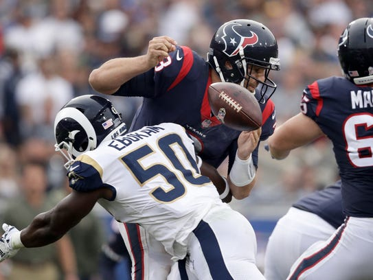 Rams linebacker Samson Ebukam forces a fumble by Texans