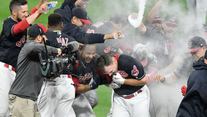 Cleveland Indians right fielder Jay Bruce (front center) is congratulated after his game-winning, RBI single in the tenth inning against the Kansas City Royals at Progressive Field. Mandatory Credit: David Richard-USA TODAY Sports