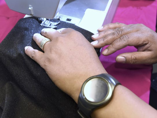 Pearl Renee Goss uses a heavy-duty sewing machine to