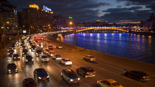 Cars drive along the wide multi-lane highway along a bank of the Moskva River,  in central Moscow, Russia, Thursday, Nov. 5, 2015.