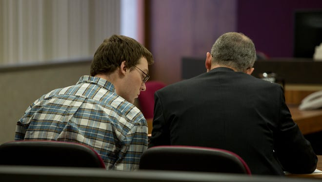 Andrew Maison speaks with his lawyer, Frederick Lepley, during his and Hilery Maison's trial Tuesday, Jan. 26, 2016 in the courtroom of Judge Daniel Kelly at the St. Clair County Courthouse in Port Huron.