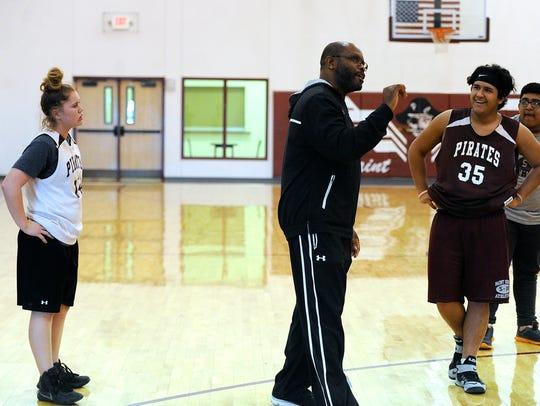 Paint Creek head coach Aaron Ashford (center) gives