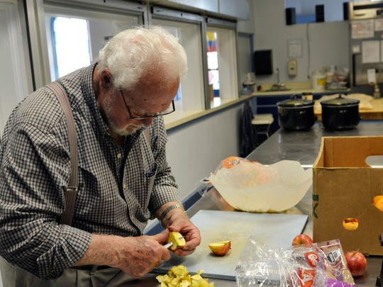 Paul Kopidlansky prepares a fruit salad for dinner at First Presbyterian Church in Manitowoc on Wednesday, May 25. Kopidlansky comes each week to prepare meals and serve members of the community through a free Wednesday night dinner.