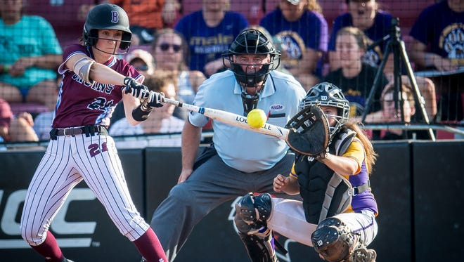 Ballard Bruins Kristen Klimesh (21) connects for a double during the Seventh Region softball tournament semifinals game 1 against the Male Bulldogs at Ulmer Stadium in Louisville, Kentucky, Wednesday, May 03, 2018.