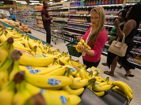 Allison Jenness, 37, of Naples, a personal shopper for Instacart, demonstrates for The News-Press what she typically does as part of her service. Instacart provides customers with personal shoppers for their groceries and is accessible through a mobile phone application.
