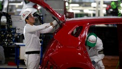 Employees at work in the multibillion-dollar Honda