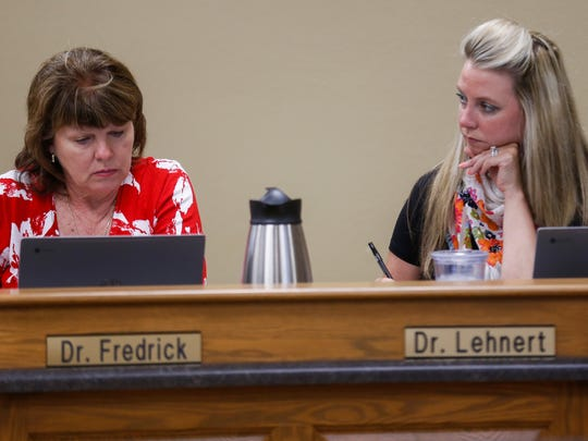 Springfield School Board members Denise Fredrick, left, and Alina Lehnert listen to public comments on Tuesday, July 17, 2018 regarding an alleged data breach.