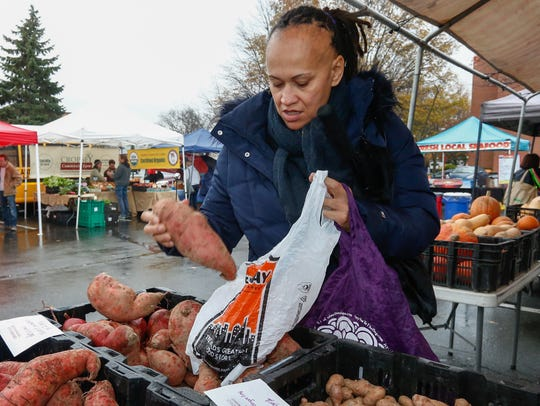 Nicole Lind of Nyack buys sweet potatoes for a her