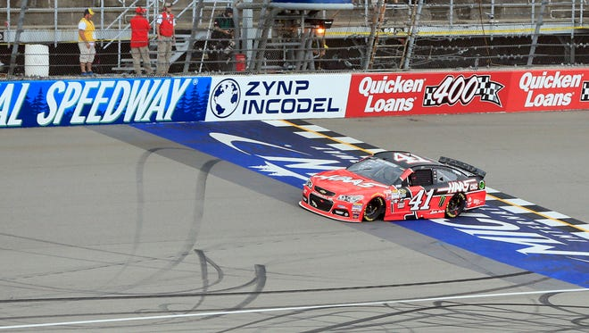 Kurt Busch drives across the finish line at Michigan International Speedway on June 14, 2015, in Brooklyn.