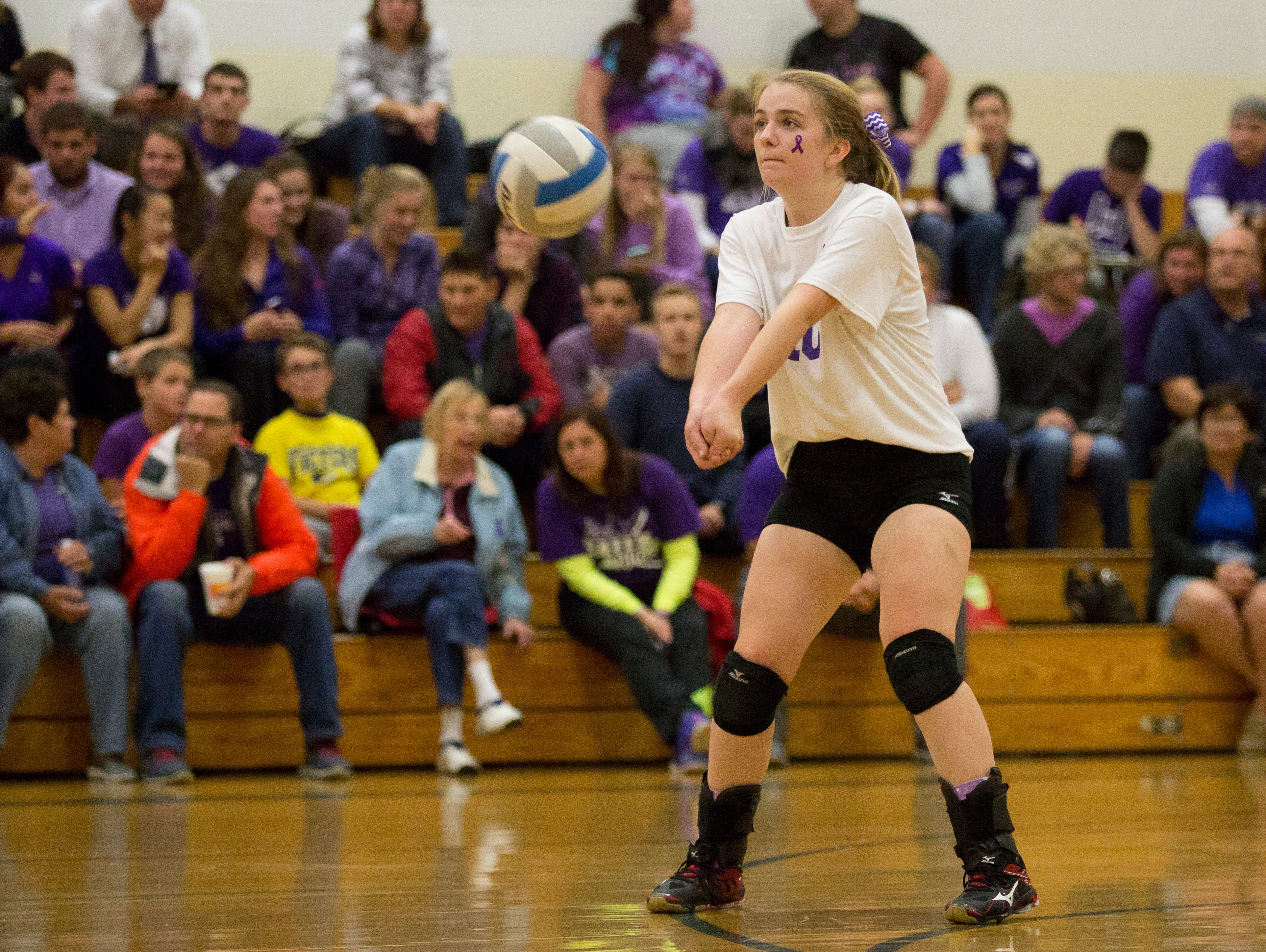 Cardinal Mooney junior Abbey Guilliat bumps the ball during a volleyball game Wednesday, October 28, 2015 at Cardinal Mooney High School.