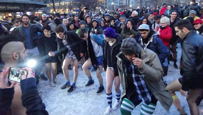 More than 4,000 people in New York City partially disrobed as part of the worldwide No Pants Subway Ride onSunday, Jan. 11, 2015.