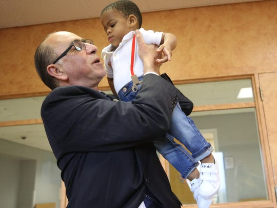 Dr. Morris Cohen, Director of the Neonatal Intensive Care Unit at Newark Beth Israel Hospital, with Soludo Onugha who was born prematurely in the Neonatal Intensive Care Unit at Newark Beth Israel Hospital in September of 2015.