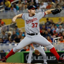 Sep 21, 2014; Miami, FL, USA; Washington Nationals starting pitcher Stephen Strasburg (37) throws the ball in the first inning in a game against the Miami Marlins at Marlins Ballpark. Mandatory Credit: Robert Mayer-USA TODAY Sports