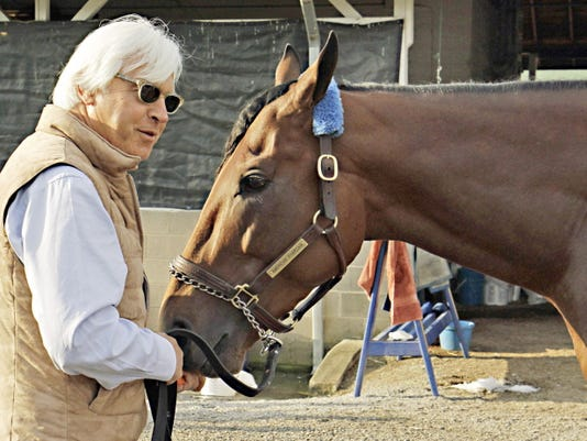 FILE In this Sunday, May 3, 2015, file photo, Hall of Fame trainer Bob Baffert, left, feeds Kentucky Derby winner American Pharoah a carrot at Churchill Downs in Louisville, Ky. Like almost every Kentucky Derby winner before him, American Pharoah is facing the inevitable question of whether he can win the Triple Crown. It hasn't been done since 1978, and with him and third-place Dortmund both trained by Baffert, it'll be interesting to see what happens at the Preakness.