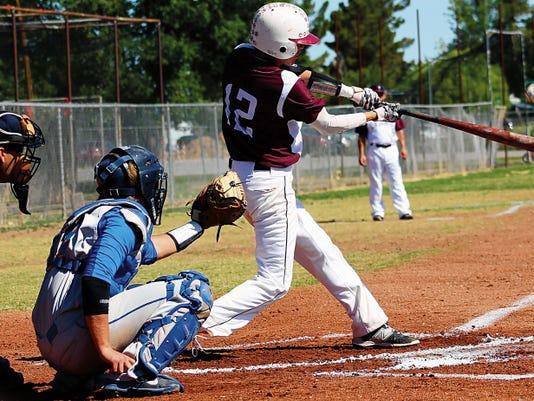 Dawson Prudencio connects for a single Saturday morning at the Tularosa High School baseball field.