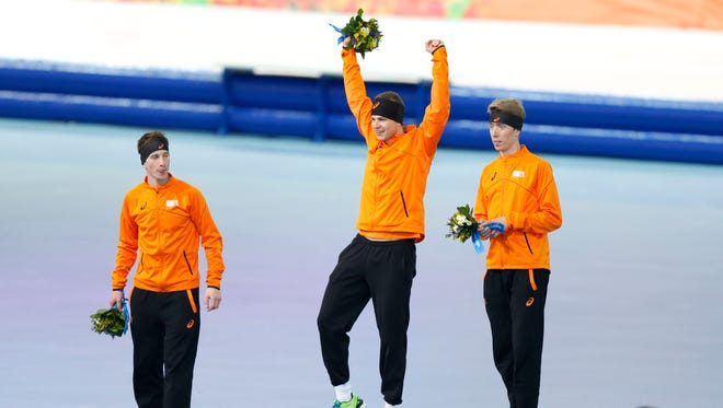 Sven Kramer, center, with gold, Jan Blokhuijsen, left, with silver and Jorrit Bergsma with bronze make it a clean sweep for Netherlands in the men's 5,000.