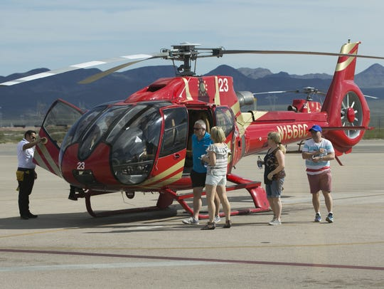 Passengers get off a Papillon Grand Canyon Helicopter
