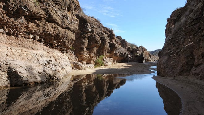 Heading east on the Hassayampa River route leads to some of the most majestic views of Box Canyon, but hikers' feet won't stay dry.