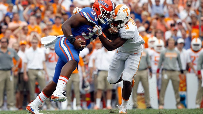 Sep 16, 2017; Gainesville, FL, USA; Florida Gators linebacker David Reese (33) intercepts the ball as Tennessee Volunteers running back Ty Chandler (3) defends during the first quarter at Ben Hill Griffin Stadium. Mandatory Credit: Kim Klement-USA TODAY Sports