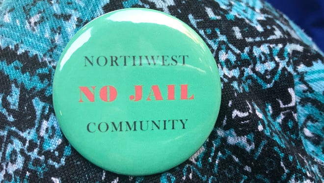 The Northwest Community No Jail buttons were worn by community members opposed to the safety center planned for 3343 Dewine Road.