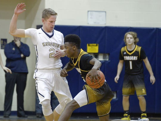 Greece Athena's Nigel Scantlebury, right, is defended