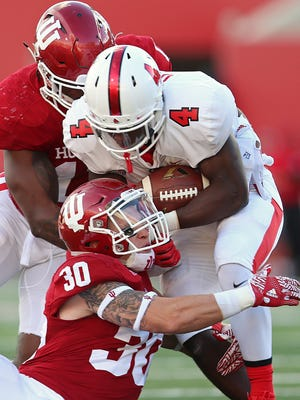 Some players, including Malik Dunner, had to give up their jersey numbers this spring. The rising sophomore is wearing No. 21 for now. Here, he is tackled by an Indiana defender on September 10, 2016.