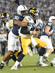 Penn State's Kevin Givens sacks Iowa quarterback C.J.